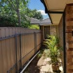Side of house and pergola enclosure – Greenwith